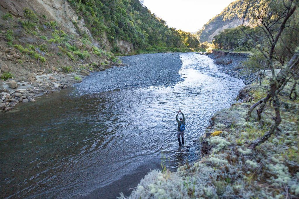 fly fishing backing fish running down mountain stream
